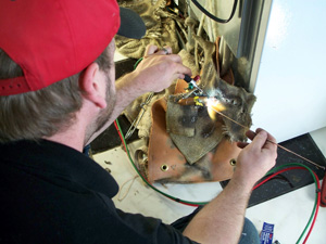 MARS Service Technician brazes in an access valve.
